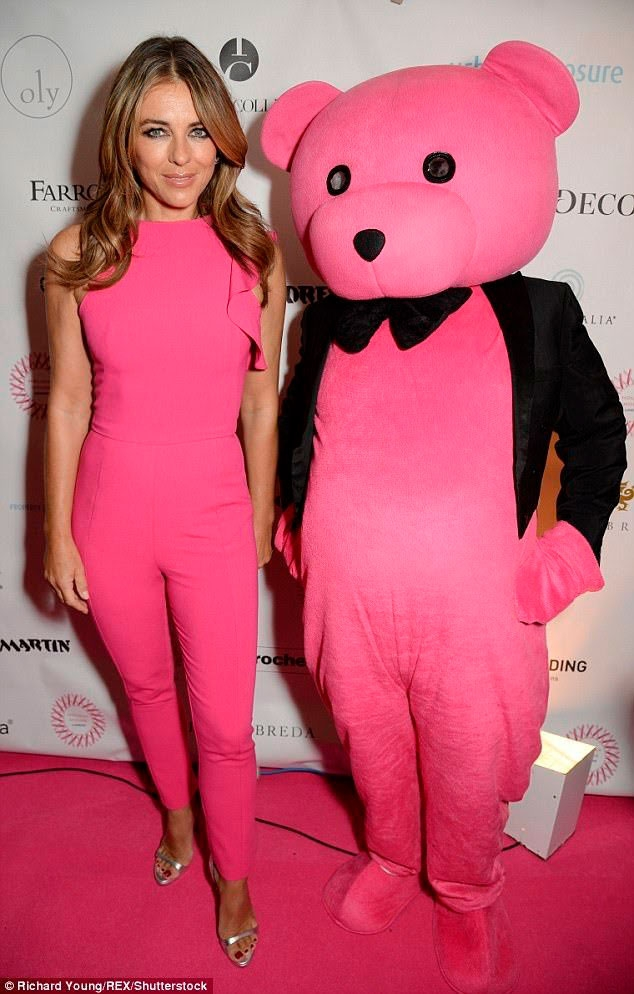 Pink Bear and Elizabeth Hurley colour coordinated at Holiday House