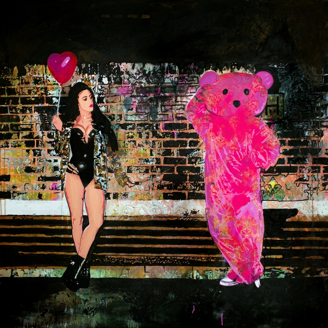 Victoria Tansey poses with the Pink Bear dressed in rubber